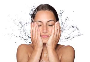 Lady Splashing Water On Face
